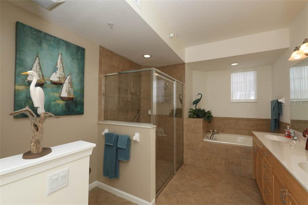 Master bathroom has walk-in shower and garden tub - Condo for sale at 4643 Club Dr #102, Port Charlotte, FL 33953 - MLS Number is C7413207