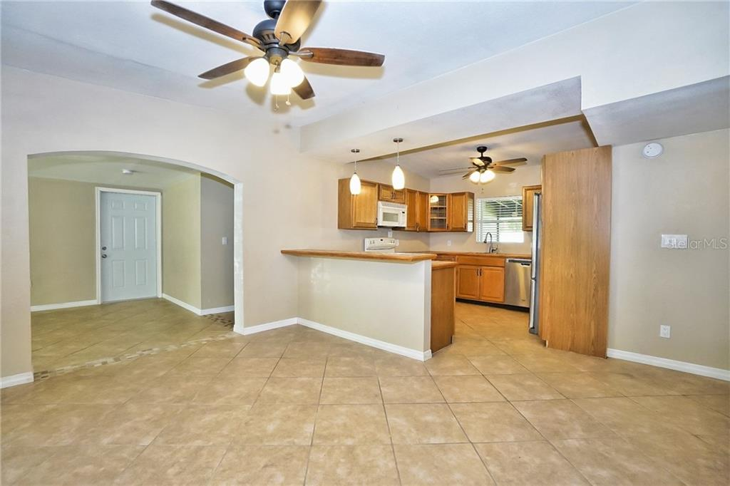 Dining Area & View of Kitchen - Single Family Home for sale at 3513 Areca St, Punta Gorda, FL 33950 - MLS Number is C7414620