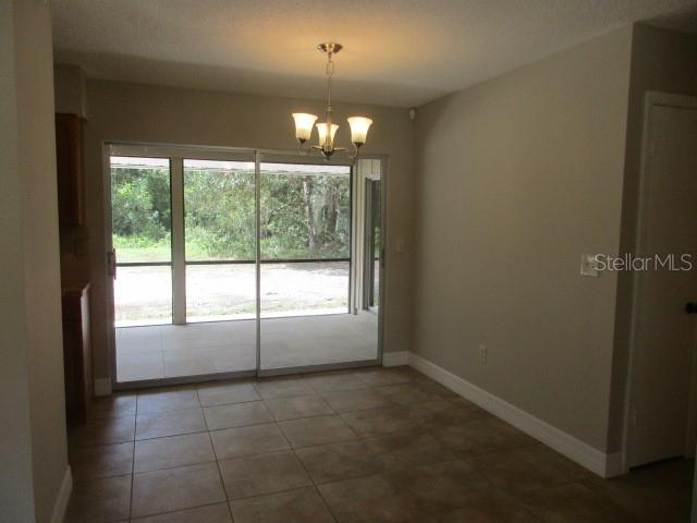 VIEW OF DINING AREA FROM FRONT ENTRY - Single Family Home for sale at 925 Tropical Ave Nw, Port Charlotte, FL 33948 - MLS Number is C7417107
