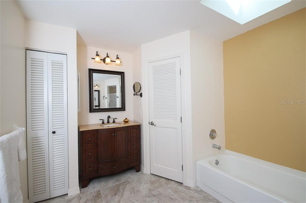 Owners bath with vanity 2, linen & tub & separate shower. - Single Family Home for sale at 2713 Saint Thomas Dr, Punta Gorda, FL 33950 - MLS Number is C7417491