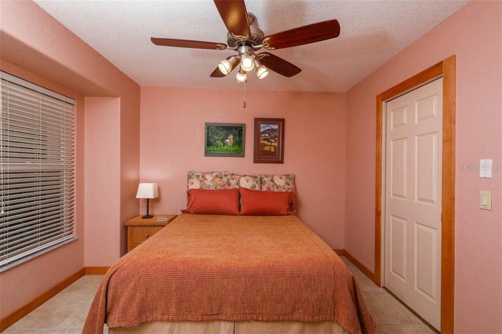 The second bedroom has a double closet and is conveniently situated next to the 2nd bath. - Single Family Home for sale at 1633 Islamorada Blvd, Punta Gorda, FL 33955 - MLS Number is C7418555
