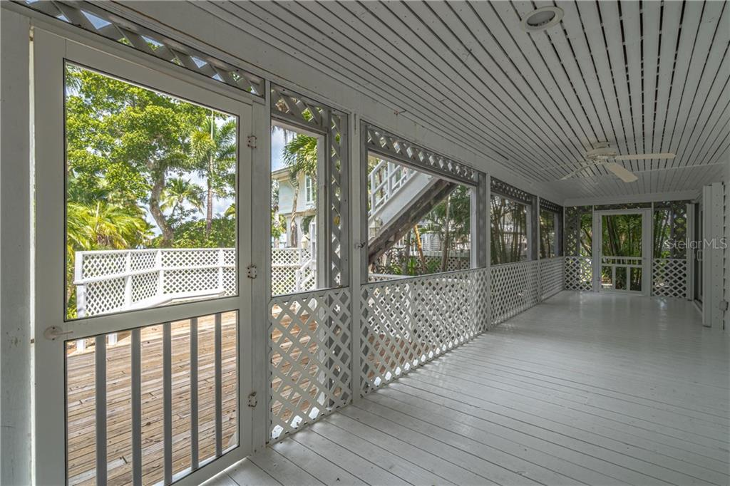 Lower level back porch measures 37x8 and opens to the recent back deck - Single Family Home for sale at 124 Useppa Is, Captiva, FL 33924 - MLS Number is C7419408