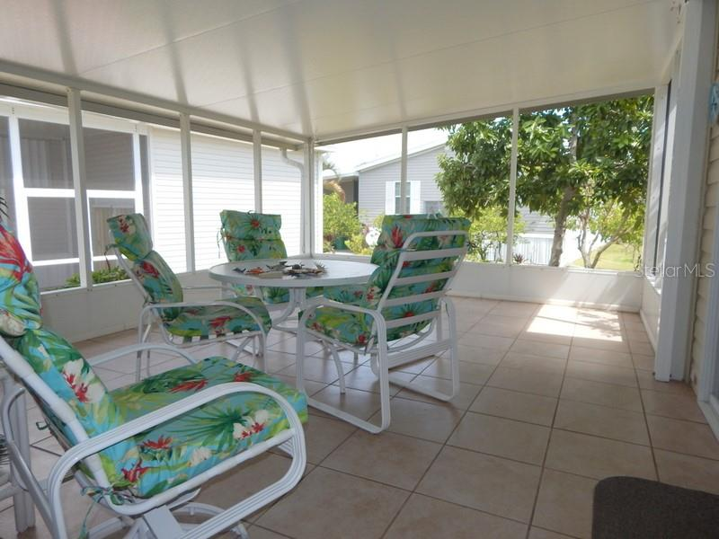 Orange and avocado trees in the back yard - Manufactured Home for sale at 31 Freeman Ave, Punta Gorda, FL 33950 - MLS Number is C7420702