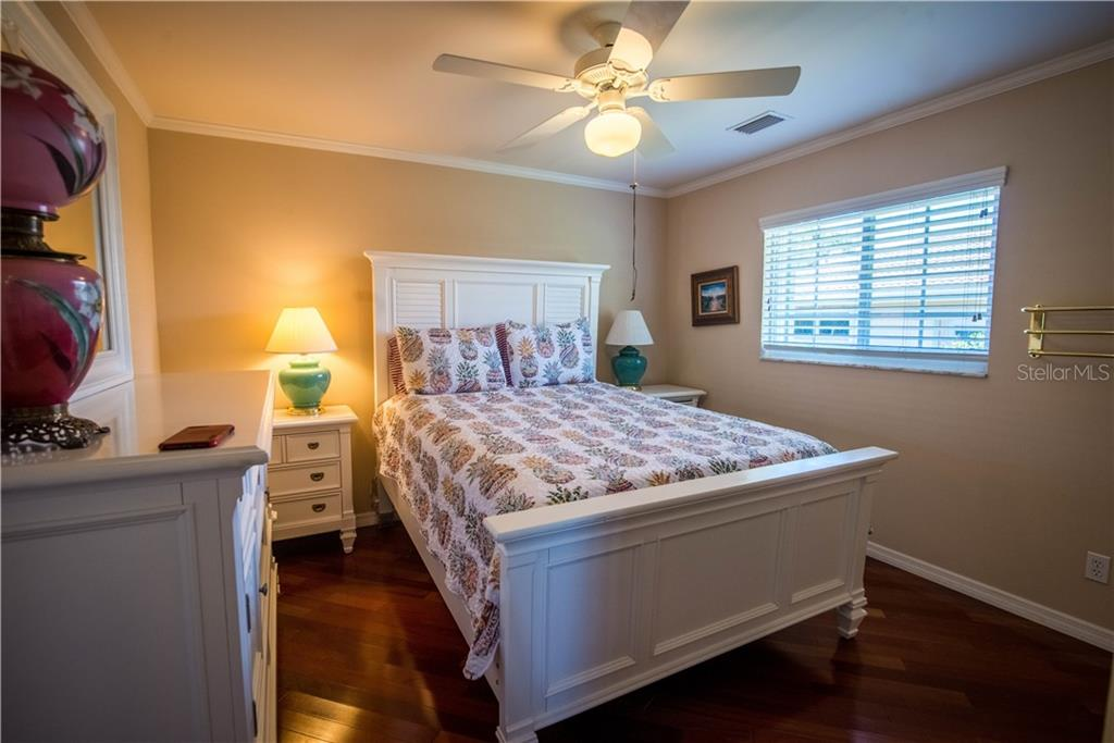 Another guest bedroom with shared, adjoining guest bath. - Single Family Home for sale at 1440 Appian Dr, Punta Gorda, FL 33950 - MLS Number is C7425399