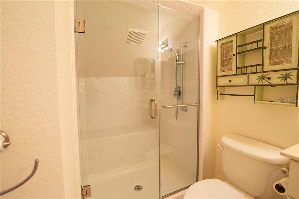 The third level offers a full bathroom with shower. - Condo for sale at 4410 Warren Ave #511, Port Charlotte, FL 33953 - MLS Number is C7432222