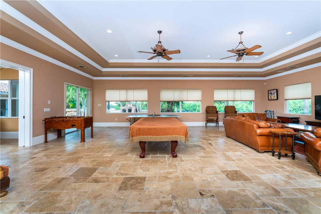 Plenty of areas for casual relaxation and gathering are offered - Single Family Home for sale at 7440 Riverside Dr, Punta Gorda, FL 33982 - MLS Number is C7436263