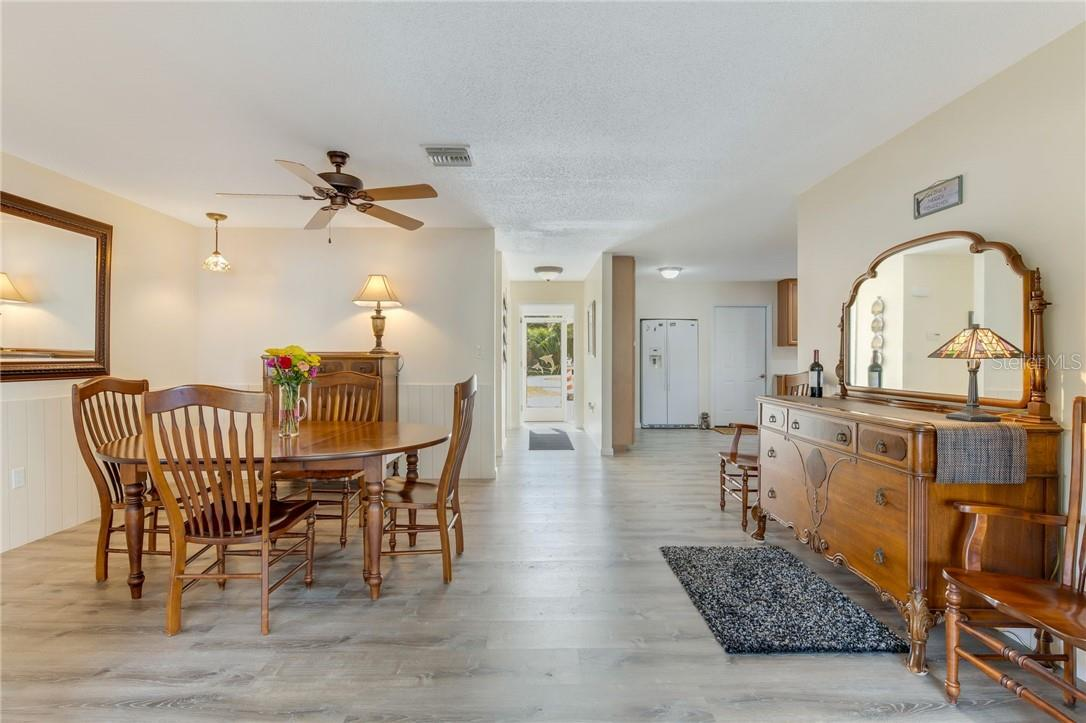 Dining room looking to front entrance and kitchen. - Single Family Home for sale at 24368 Blackbeard Blvd, Punta Gorda, FL 33955 - MLS Number is C7436898