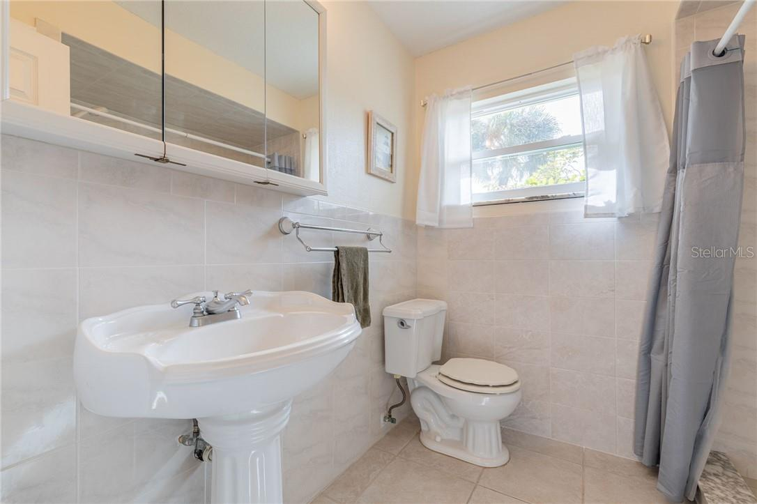 Bath for Bedrooms 2 and 3 features a brand new tile, spa-like step in shower, new comfort toilet and pedestal sink. - Single Family Home for sale at 24368 Blackbeard Blvd, Punta Gorda, FL 33955 - MLS Number is C7436898
