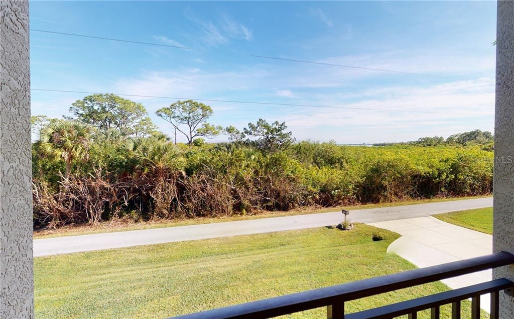 View from the 2 story front balcony. - Single Family Home for sale at 4245 Spire St, Port Charlotte, FL 33981 - MLS Number is C7437570