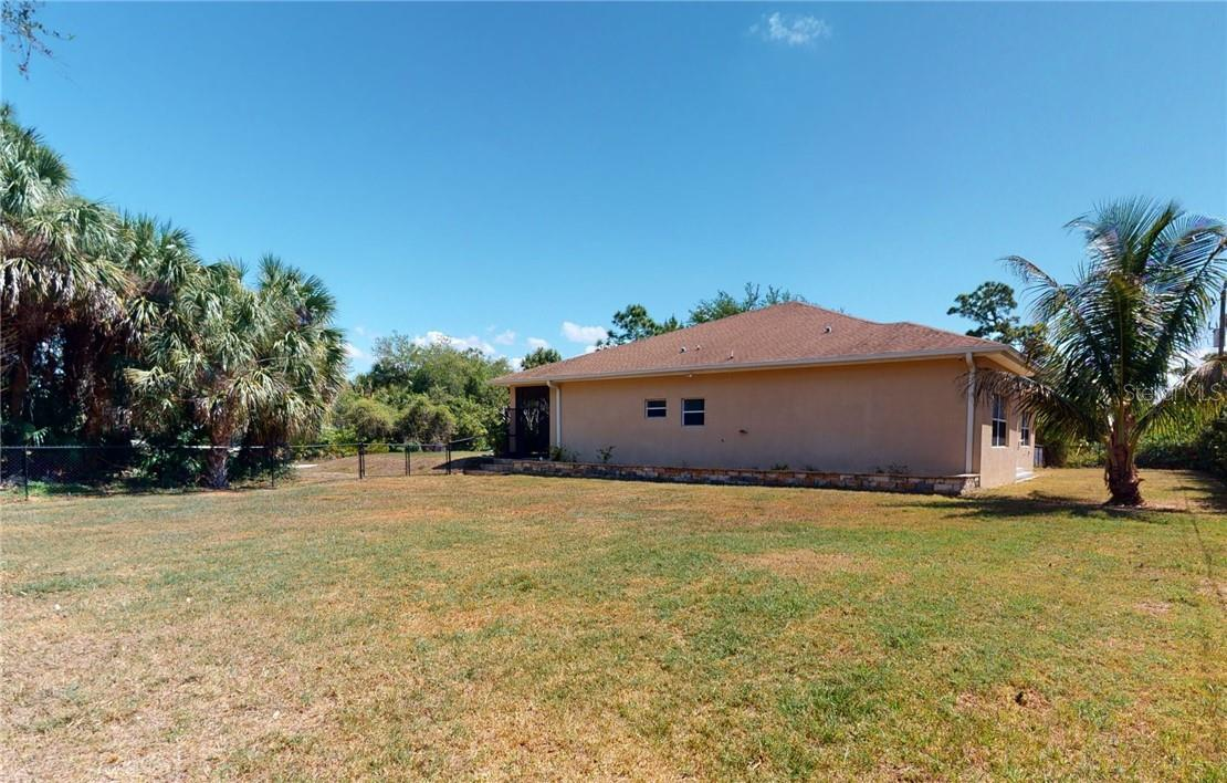 Looking from extra lot to side. - Single Family Home for sale at 11905 Florence Ave, Port Charlotte, FL 33981 - MLS Number is C7441003