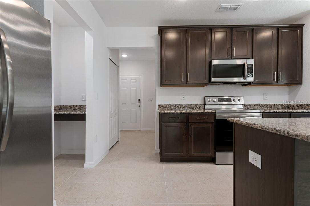 Kitchen comes with new stainless steel appliances. - Single Family Home for sale at 2082 Apian Way, Port Charlotte, FL 33953 - MLS Number is C7441465