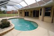 Screened pool enclosure with closet storage room.  Access from Master bedroom, Great room and guest bedroom hall and one bedroom. - Single Family Home for sale at 7376 Schefflera, Punta Gorda, FL 33955 - MLS Number is C7245991
