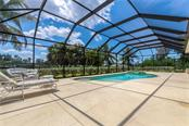 Pool deck stretches fully across the home.  Plenty of room for sun & shade. - Single Family Home for sale at 931 Linkside Way, Punta Gorda, FL 33955 - MLS Number is C7400849