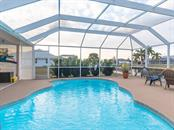 YOUR POOL IS CALLING YOU!!! - Single Family Home for sale at 15464 Avery Rd, Port Charlotte, FL 33981 - MLS Number is C7401914