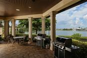 Bring your steaks and grill while overlooking the beautiful lake - Condo for sale at 95 Vivante Blvd #303, Punta Gorda, FL 33950 - MLS Number is C7402746
