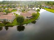 Aerial view of the house - Single Family Home for sale at 8663 Lake Front Ct, Punta Gorda, FL 33950 - MLS Number is C7403960