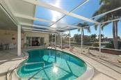 Owner Suite beyond pool. - Single Family Home for sale at 2291 Bayview Rd, Punta Gorda, FL 33950 - MLS Number is C7409445