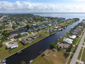 View to south & Punta Gorda across the river. Boat over to several restaurants! - Single Family Home for sale at 126 Bangsberg Rd Se, Port Charlotte, FL 33952 - MLS Number is C7409866