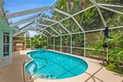 A lush and tropical paradise is waiting for you! - Single Family Home for sale at 1633 Islamorada Blvd, Punta Gorda, FL 33955 - MLS Number is C7418555