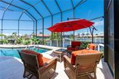 LANAI WITH BIG WATER VIEWS - Single Family Home for sale at 3537 Caya Largo Ct, Punta Gorda, FL 33950 - MLS Number is C7431664