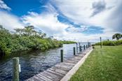 Literally right outside your front door are foot docks that are perfect for casting a line or launching a kayak, canoe or boat for a trip to surrounding waters and beaches. So much to explore! - Condo for sale at 4410 Warren Ave #511, Port Charlotte, FL 33953 - MLS Number is C7432222