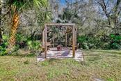Custom built firepit with swings - Single Family Home for sale at 10230 Sw County Road 769, Arcadia, FL 34269 - MLS Number is C7437596