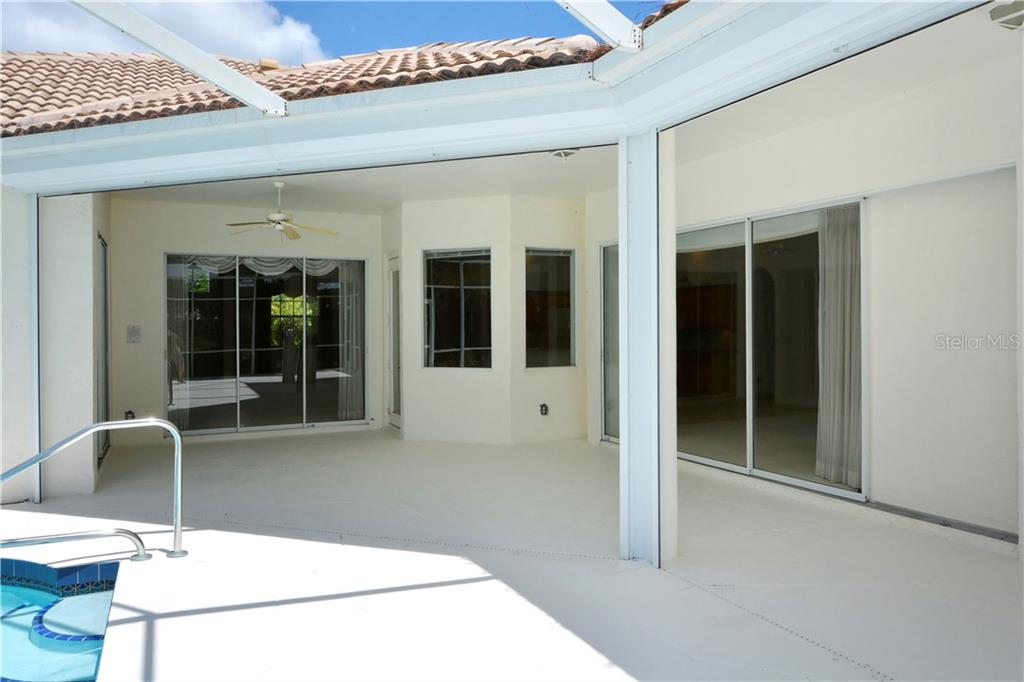 Lots of under-roof space on the lanai. - Single Family Home for sale at 8753 Merion Ave, Sarasota, FL 34238 - MLS Number is A4165409