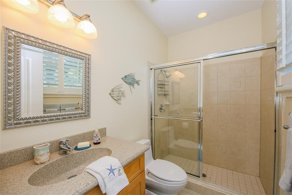 Master bathroom - Single Family Home for sale at 827 Paradise Way, Sarasota, FL 34242 - MLS Number is A4167744
