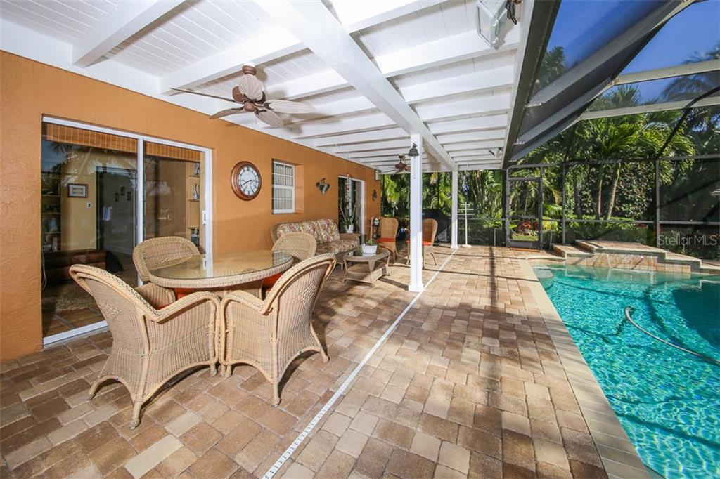 Covered, screened paver lanai - Single Family Home for sale at 5281 Cape Leyte Way, Sarasota, FL 34242 - MLS Number is A4171478