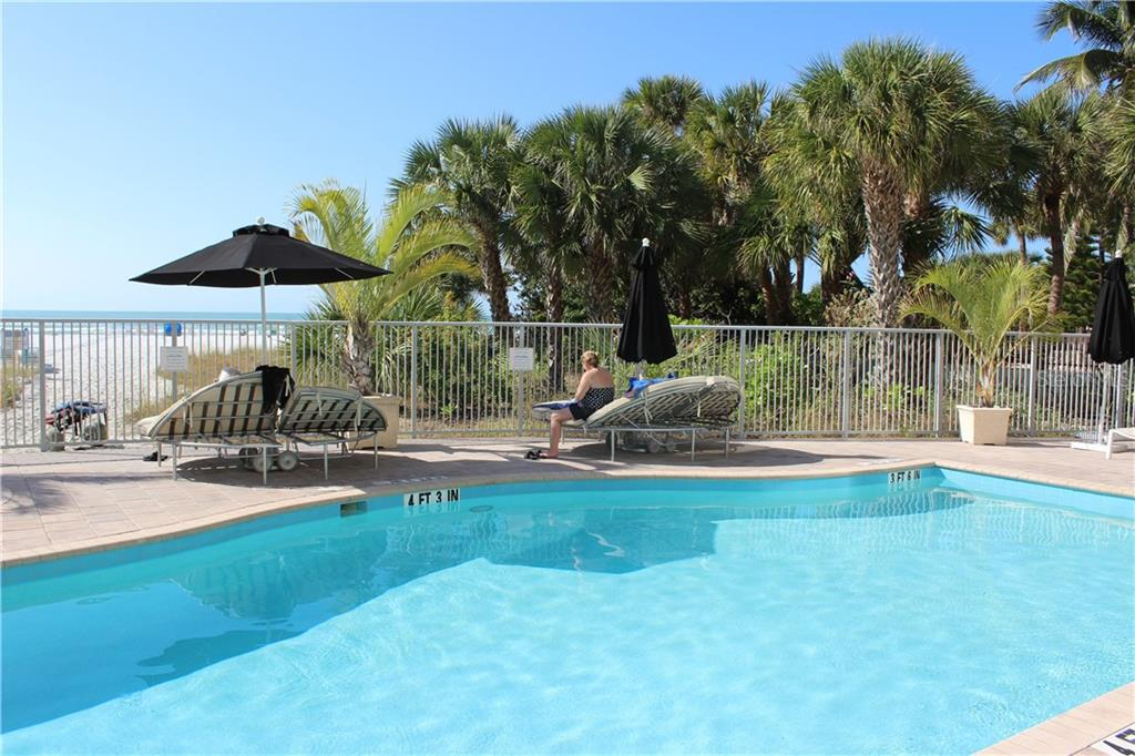 Beach front pool, spa, grilles. - Condo for sale at 6512 Midnight Pass Rd #406, Sarasota, FL 34242 - MLS Number is A4171720