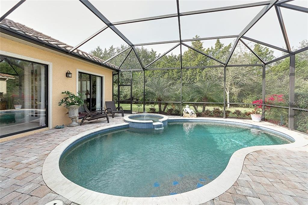 Privately landscaped brick paver patio with gas heated pool and spa - Single Family Home for sale at 7254 Lake Forest Gln, Lakewood Ranch, FL 34202 - MLS Number is A4174107