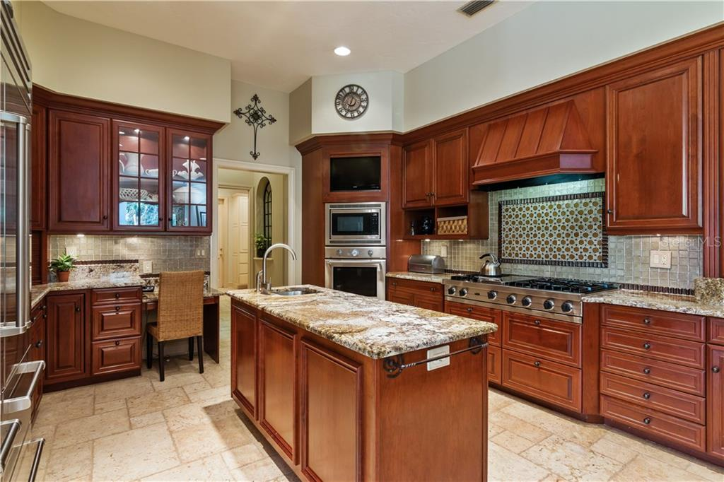 Upgraded Thick Slab Granite, Thermador Ovens, 2 Thermador Dishwashers, Sub Zero Refrigerators/Freezers - Single Family Home for sale at 8130 Perry Maxwell Cir, Sarasota, FL 34240 - MLS Number is A4175735