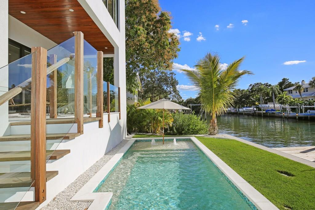 Bring your umbrella and chairs, enjoy sitting and watching the boats go by IN the pool. - Single Family Home for sale at 4934 Commonwealth Dr, Sarasota, FL 34242 - MLS Number is A4175945