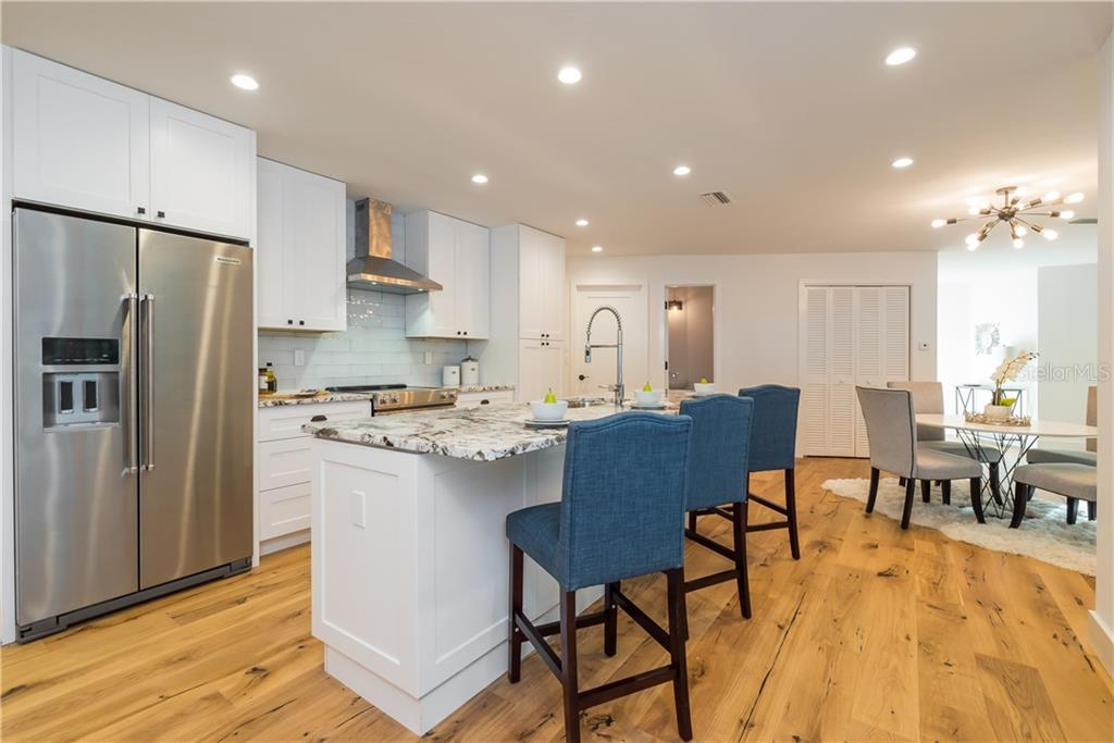 Custom white shaker cabinetry, granite counter tops and brand new stainless steel appliances. - Single Family Home for sale at 5115 Dewey Pl, Sarasota, FL 34242 - MLS Number is A4177178
