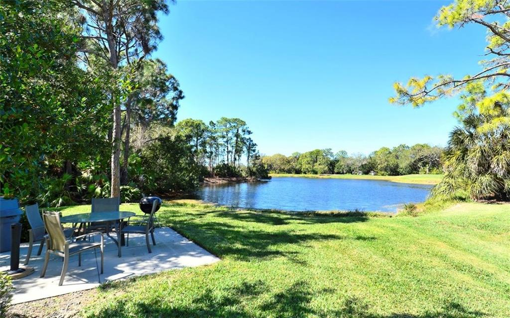 Terraces Community barbecue area overlooks a glistening lake. - Condo for sale at 8750 Olde Hickory Ave #9305, Sarasota, FL 34238 - MLS Number is A4178271