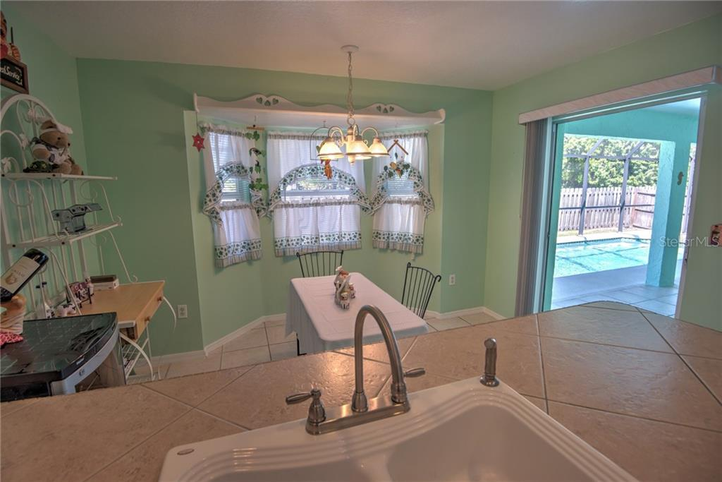 Nook area off pool area - Single Family Home for sale at 7718 36th Ln E, Sarasota, FL 34243 - MLS Number is A4181555