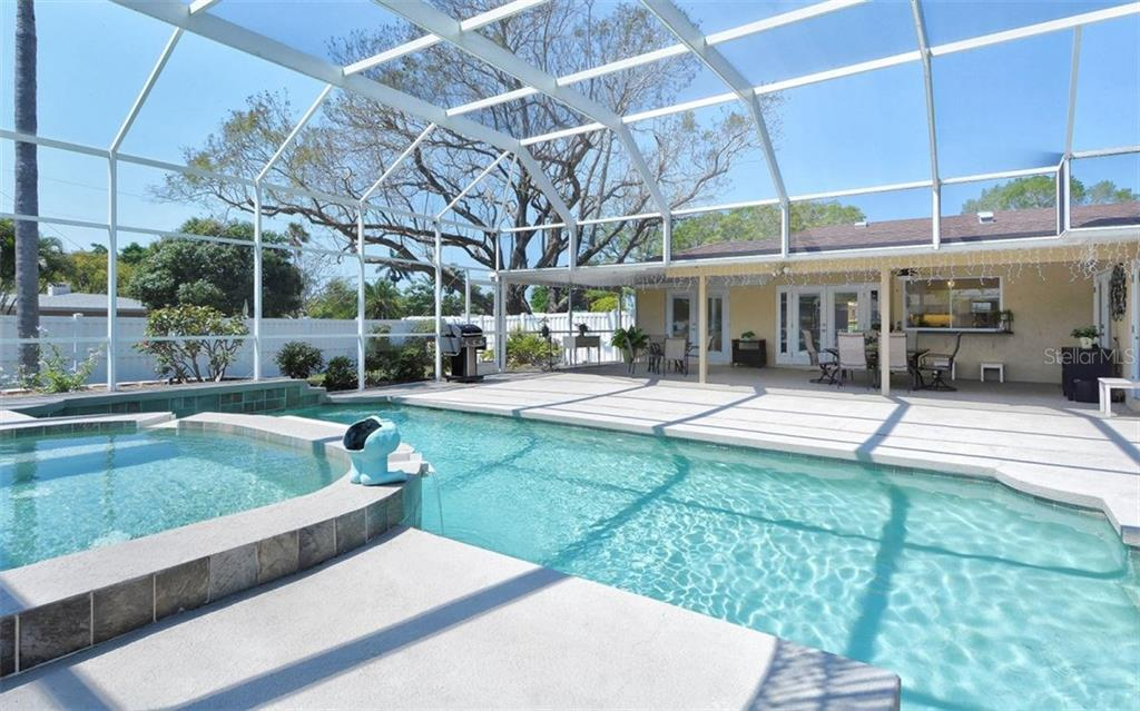 Very private pool and lanai.  Large Jacaranda tree on the side yard. - Single Family Home for sale at 6239 Hollywood Blvd, Sarasota, FL 34231 - MLS Number is A4182790