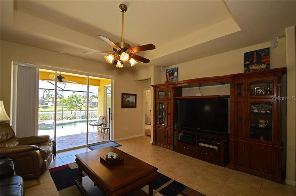Family Room - Single Family Home for sale at 9006 Heritage Sound Dr, Bradenton, FL 34212 - MLS Number is A4183771
