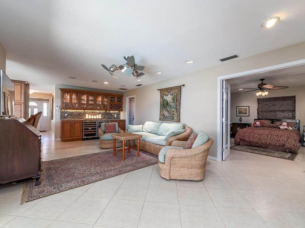 Living room and Foyer - Single Family Home for sale at 551 Putting Green Ln, Longboat Key, FL 34228 - MLS Number is A4183977