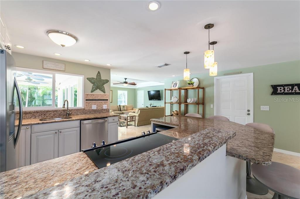 Breakfast bar seats four comfortably. - Single Family Home for sale at 413 Bay Palms Dr, Holmes Beach, FL 34217 - MLS Number is A4184679