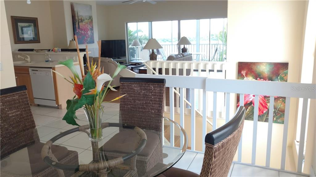 Open living dining kitchen - Condo for sale at 9209 Midnight Pass Rd #5, Sarasota, FL 34242 - MLS Number is A4185067