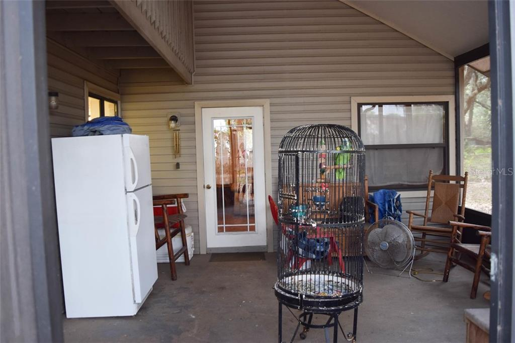 Covered and screened back porch - Single Family Home for sale at 1019 51st Ave E, Bradenton, FL 34203 - MLS Number is A4185257