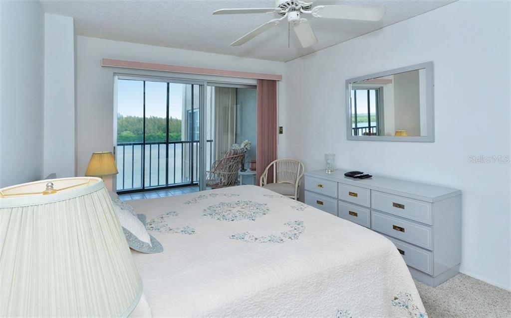 Master bedroom with sliders to balcony - Condo for sale at 9397 Midnight Pass Rd #403, Sarasota, FL 34242 - MLS Number is A4185842