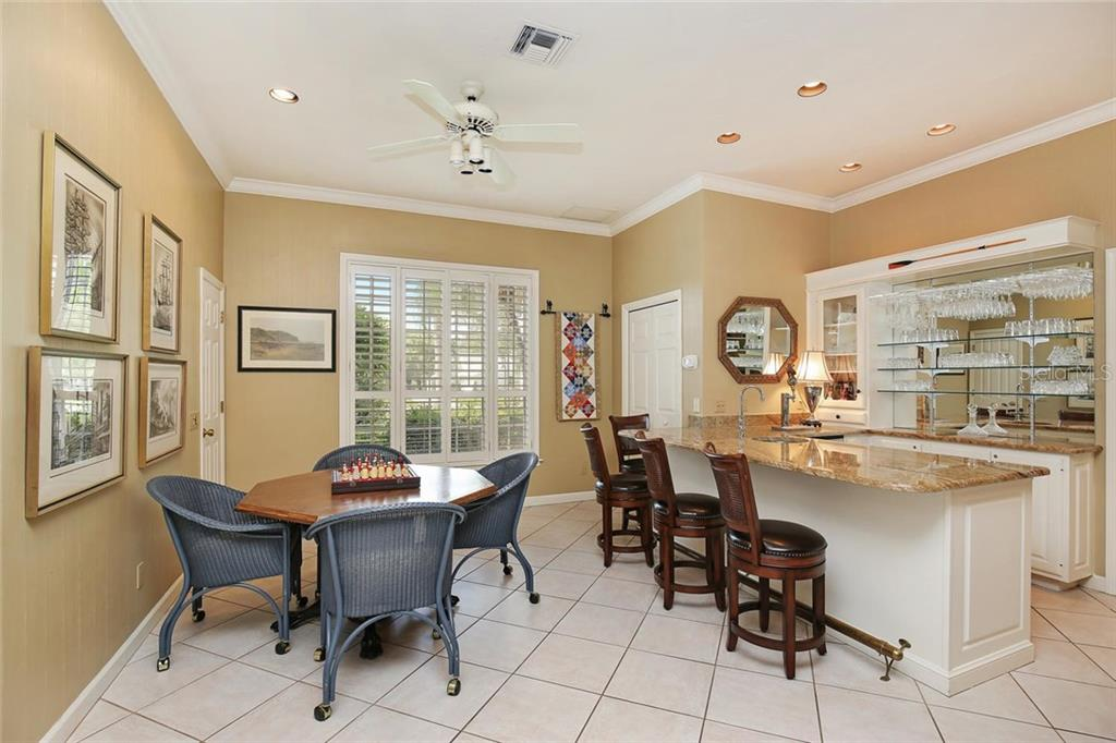 Family room extension with a fantastic wet bar and extra seating area for a fun game of chess! - Single Family Home for sale at 3765 Beneva Oaks Blvd, Sarasota, FL 34238 - MLS Number is A4185879