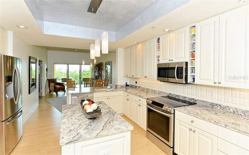 Kitchen - Condo for sale at 1310 Old Stickney Point Rd #e53, Sarasota, FL 34242 - MLS Number is A4186018