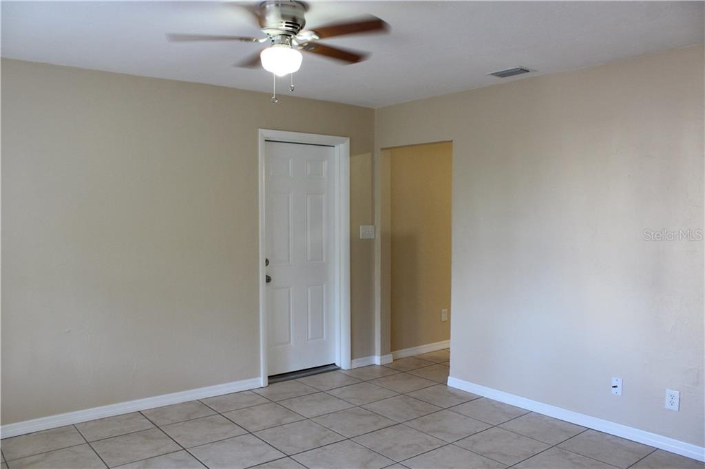 Garage access from the great room. New ceiling fans. - Single Family Home for sale at 938 Highland St, Sarasota, FL 34234 - MLS Number is A4186423