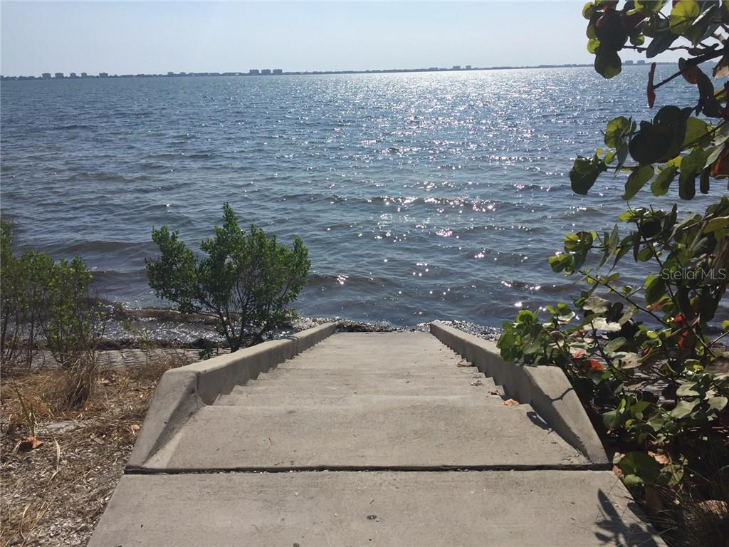 Access steps to Sarasota Bay from Sunset Park. - Single Family Home for sale at 938 Highland St, Sarasota, FL 34234 - MLS Number is A4186423