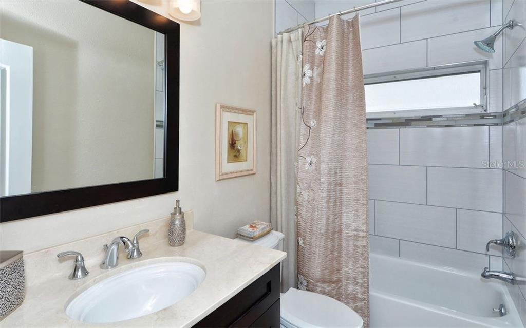 Guest Bathroom - Single Family Home for sale at 4121 Via Mirada, Sarasota, FL 34238 - MLS Number is A4186485