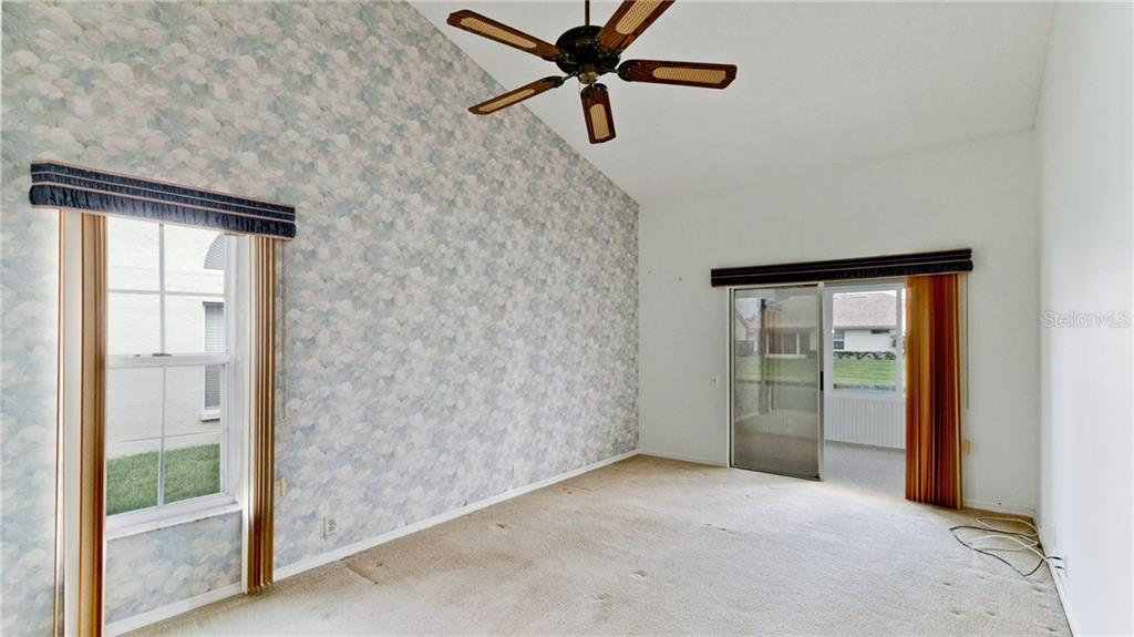 Owner's retreat with sliders to the Florida room. - Single Family Home for sale at 4517 Galloway Blvd, Bradenton, FL 34210 - MLS Number is A4187598