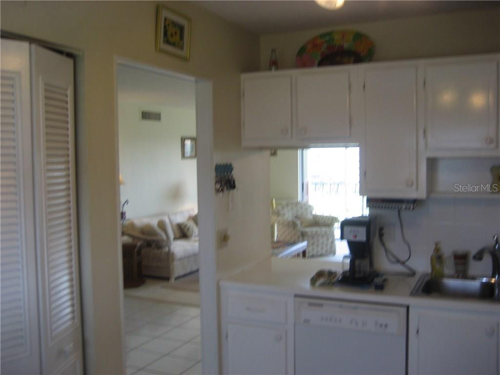 Kitchen entry is steps from the entry way - Condo for sale at 3820 Ironwood Ln #606i, Bradenton, FL 34209 - MLS Number is A4187664